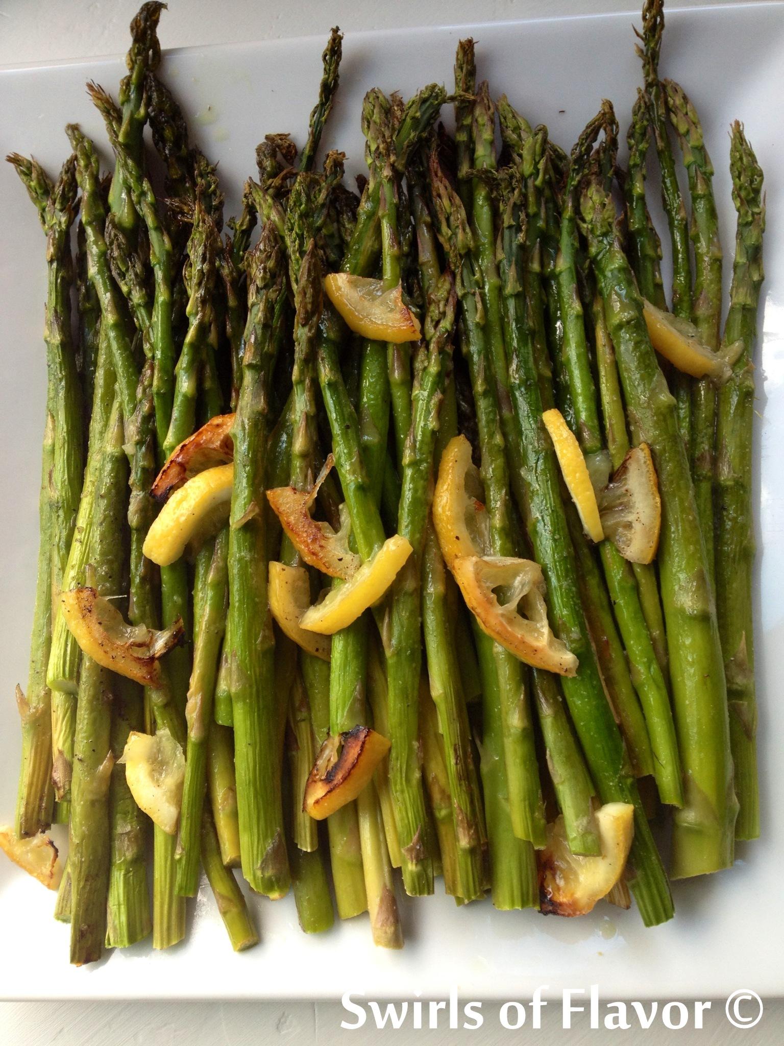 lemon roasted asparagus on white platted