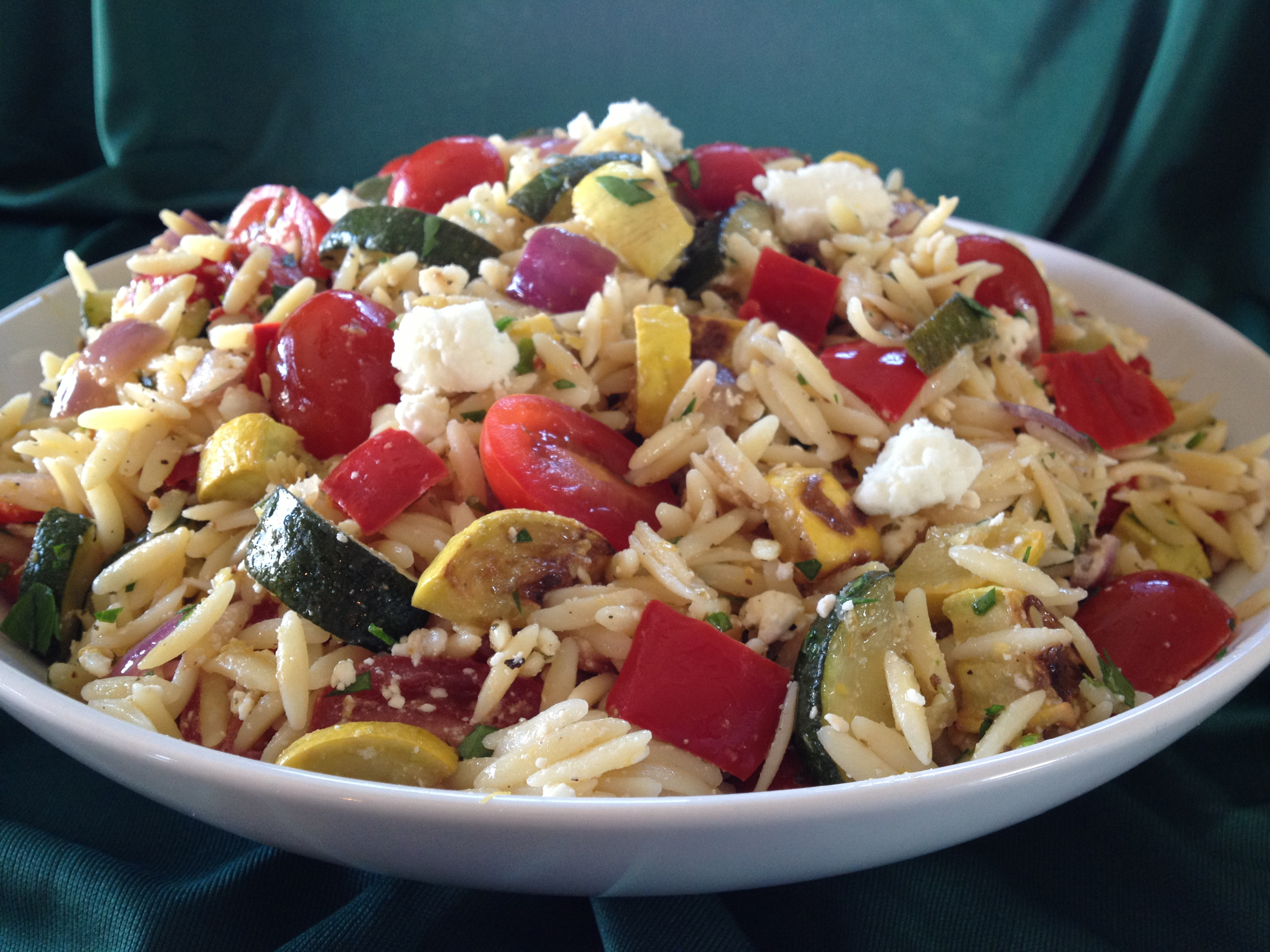 Roasted Rainbow Vegetables with Orzo & Feta combines an array of vegetable colors and flavors with pasta and a lehe perfect side dish bursting with flavor or top with cooked chicken, beef or shrimp for a meal in a bowl! easy recipe | pasta | orzo | side dish | cheese | mixed vegetables | feta | dinner | brunch | #swirlsofflavor