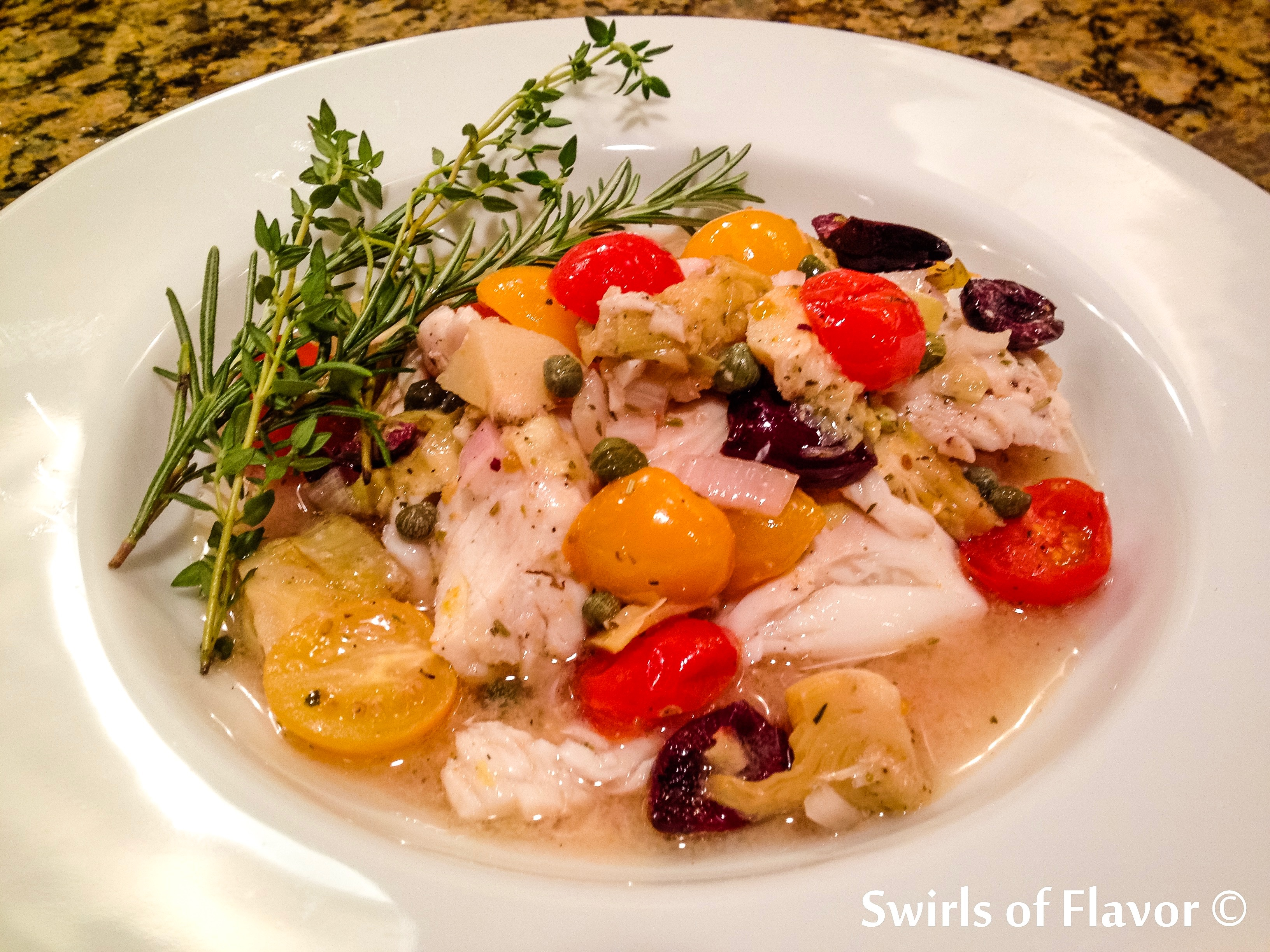 single serving of oven baked Tilapia Provencal in a bowl with fresh herbs