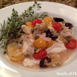 Smothered Tilapia Provencale is such an easy recipe you will want to make it over and over with shrimp and salmon too! Simply combine artichokes, olives, capers, tomatoes, shallots and garlic with white wine and olive oil, pour over tilapia and bake! The flavors of Provence in a quick dinner! #tilapia #fish #dinner #easyrecipe #bakedfish #tomatoes #shrimp #salmon #olives #swirlsofflavor