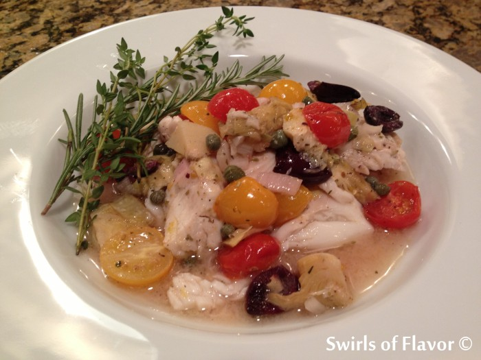Smothered Tilapia Provencale is such an easy recipe you will want to make it over and over with shrimp and salmon too! Simply combine artichokes, olives, capers,tomatoes, shallotsand garlic with white wine and olive oil, pour over tilapia and bake! The flavors of Provence in a quick dinner! #tilapia #fish #dinner #easyrecipe #bakedfish #tomatoes #shrimp #salmon #olives #swirlsofflavor