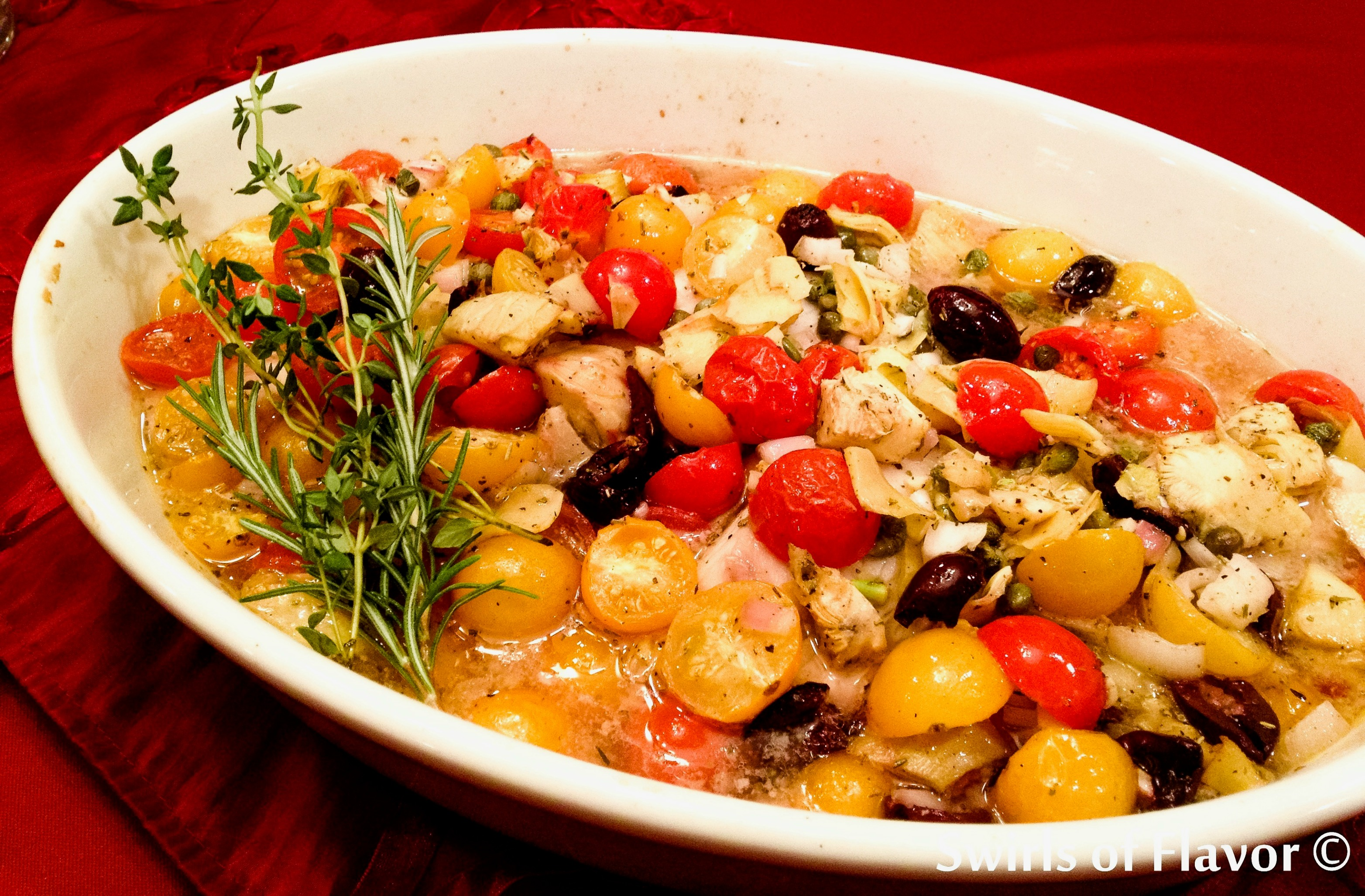 Oven Baked Tilapia Provencal in baking dish with fresh herbs