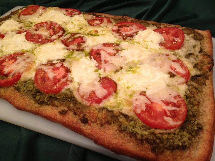 Fontina Pesto Artisinal Pizza is an easy homemade pizza recipe. All it takes is refrigerated Artisan Pizza Crust, jarred pesto, plum tomatoes and cheeses and you'll be just as gourmet as the best of them!