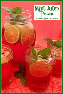 mint julep bourbon cocktail with fresh mint and lime slices