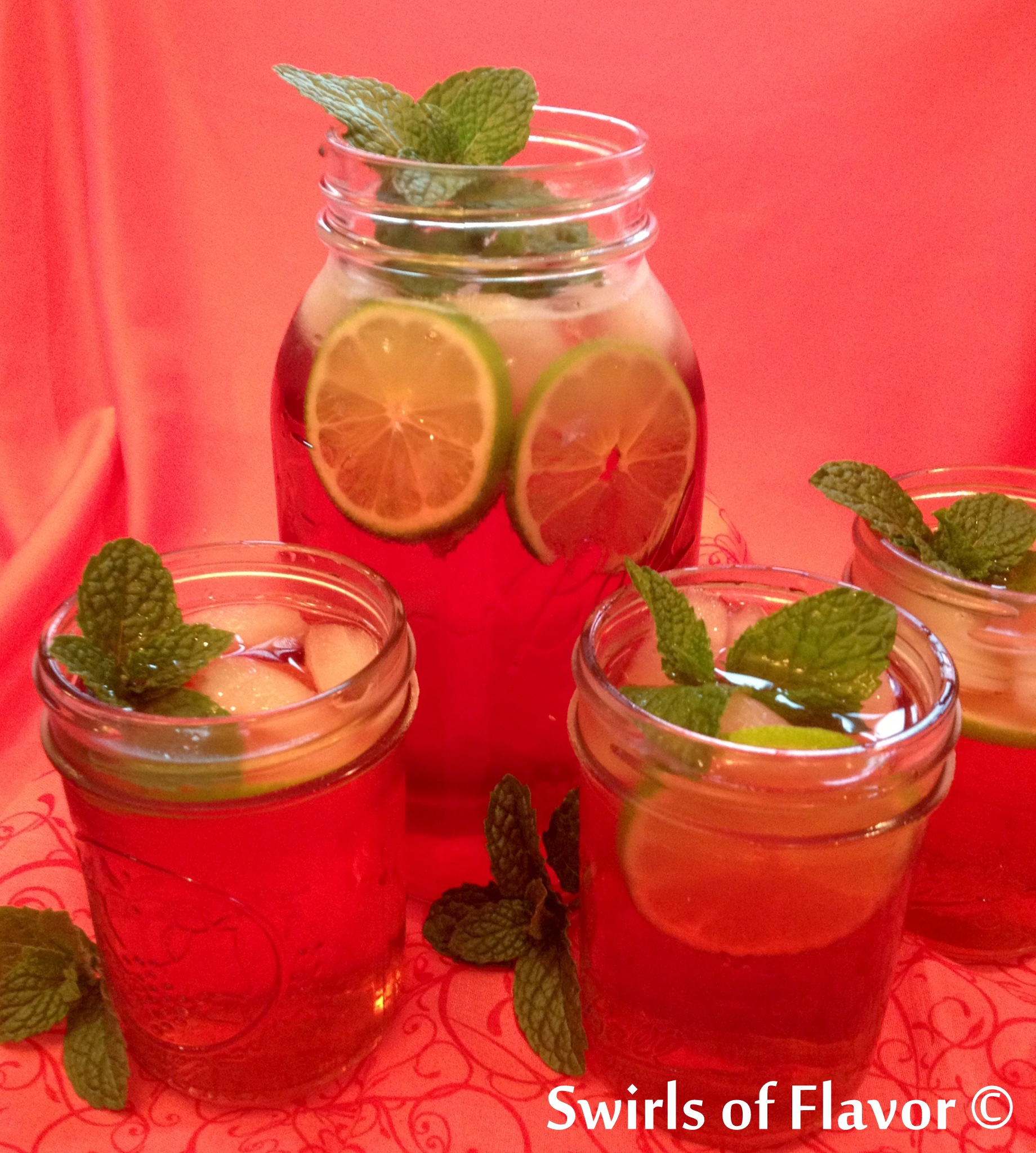 Pomegranate Lime Mint Julep Punch in mason jars