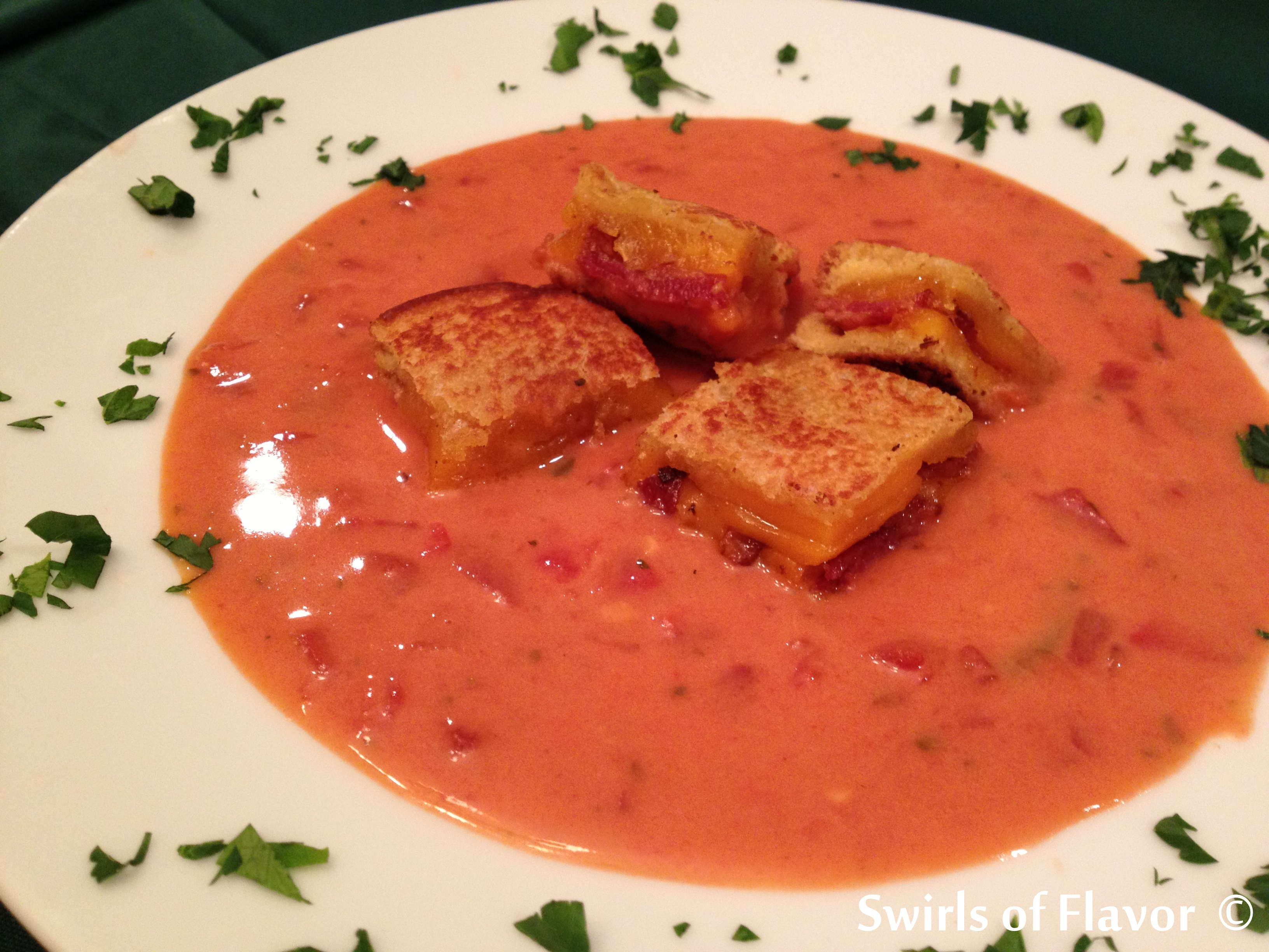 The classic Creamy Tomato Soup With Cheddar Bacon Grilled Cheese Croutons   simmers on your stove top and will warm you up on a chilly fall day topped with grilled cheese croutons of crispy bacon, sharp cheddar cheese and potato bread.