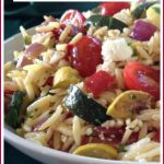 roasted vegetables, feta cheese and orzo in a bowl