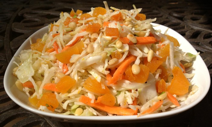 Orange Basil Cole Slaw is an easy recipe for a summer side diah. Just season your cole slaw mix with an orange and basil scented vinaigrette, stir in apricots and toasted pine nuts and you've got the perfect crunch, bursts of sweetness and nutty flavor in every mouthful!