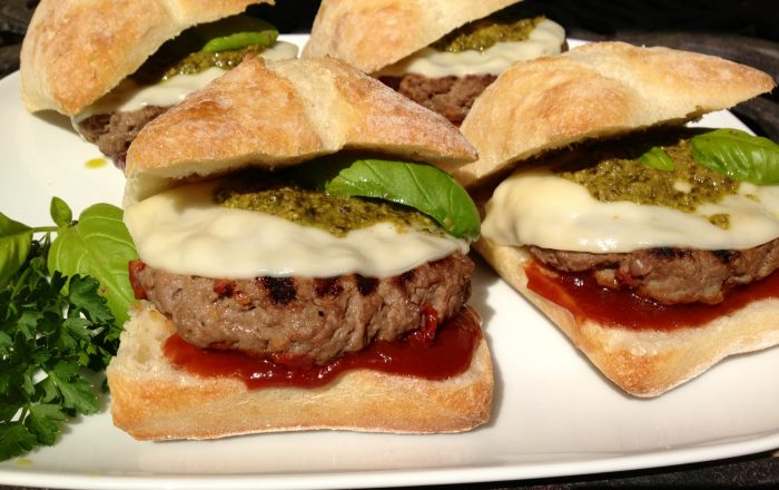 Seasoned with a zesty Italian flavorings and sundried tomatoes and topped with provolone, pesto and a Balsamic ketchup these burgers are packed with flavor! burgers | grilling | pesto | cheese | Italian | provolone | Memorial Day | barbecue