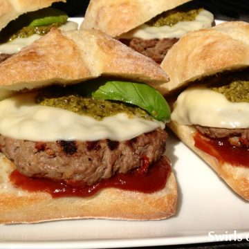 Pesto Provolone Burgers are seasoned with a zesty Italian flavoring mix and sundried tomatoes and topped with provolone, pesto and a homemade Balsamic ketchup! burgers | hamburgers | grilling | ground beef | Italian | provolone | pesto | barbecue