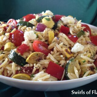 bowl of orzo with feta cheese and roasted vegetables