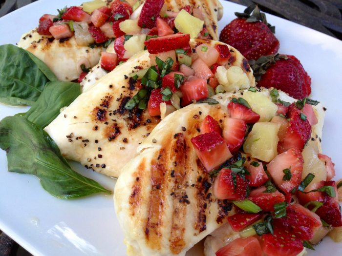 Top grilled chicken with this fabulously delicious Strawberry Basil Salsa.....quick, easy and bursting with fresh seasonal flavor..... for a perfect dinner on a hot summer's evening!