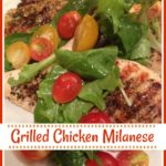 Chicken Milanese with tossed greens and tomatoes on top