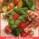Grilled chicken topped with baby greens