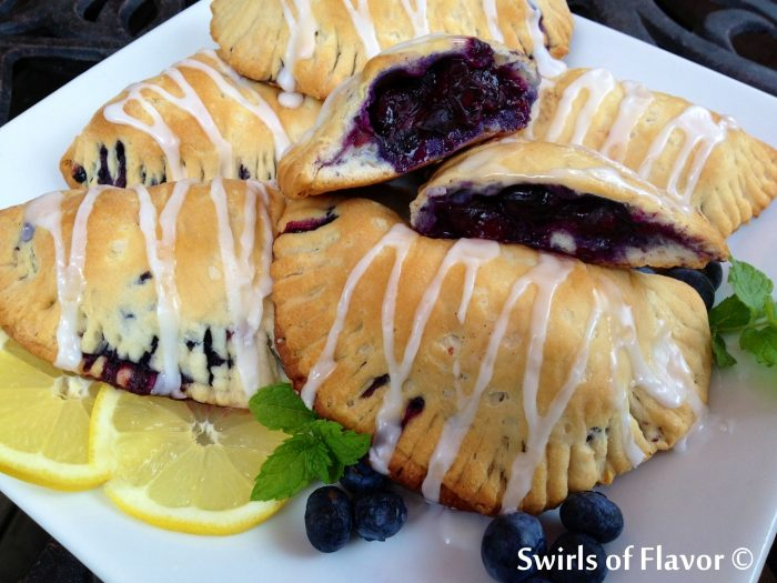 Glazed Blueberry Hand Pies are filled with fresh blueberries tossed with blueberry preserves, cinnamon and lemon and baked to perfection in a buttermilk biscuit dough and drizzled with a confectioners sugar glaze!