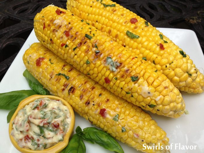Grilled Corn With Tomato Basil Butter is an easy recipe for your summer get togethers and grilling corn gives the kernels a caramelized flavor that is lip-smackin' good! easy recipe | farmers market | summer | corn on the cob | grilling | #swirlsofflavor