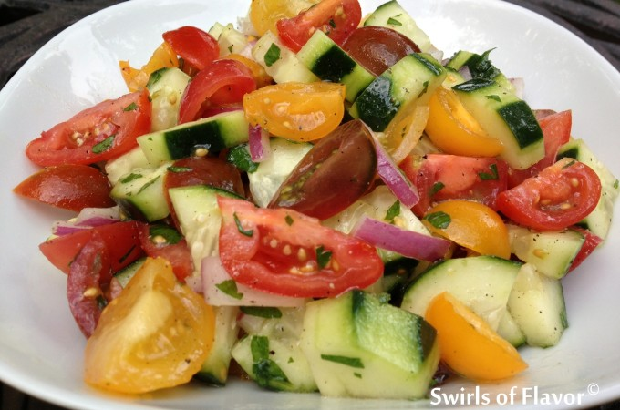 Heirloom Tomato & Cucumber Summer Salad is an easy summer side dish bursting with tomatoes and cucumbers lightly coated in a tangy red wine vinaigrette. Farmers market | vegetables | summer recipe | side dish | vinaigrette | easy recipe | #swirlsofflavor
