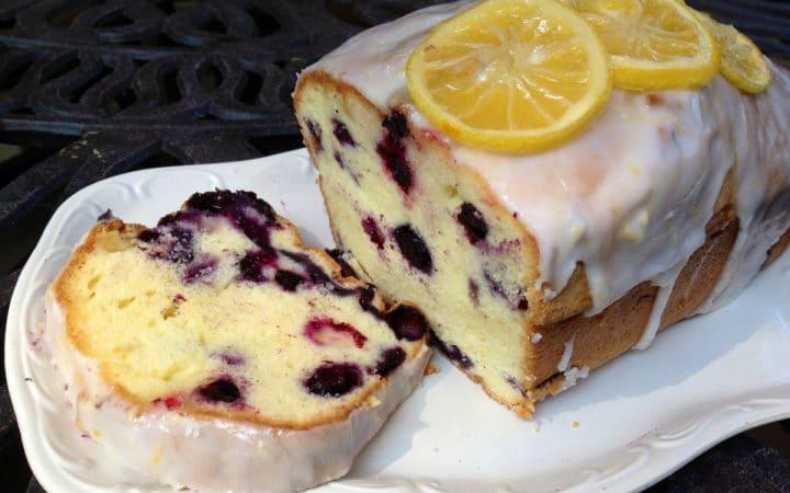 blueberry pound cake with slice on white platter
