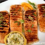 Chipotle Honey Glazed Salmon With Pistachio Butter is an easy recipe for the super fish salmon. Salmon fillets are seasoned with just the right amount of spice then glazed over with honey, a touch of orange and topped with pistachio butter that melts down over the fillets after grilling.
