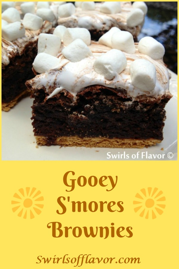 Gooey S'mores Brownies is an easy recipe that takes s'mores to another level. Graham crackers are baked into brownies and then topped with chocolate bars and marshmallow fluff creating a melty gooey chocolate marshmallow topping with mini marshmallows on top! #brownies #s'mores #brownies #marshmallowfluff #baked #dessert #funforkids #marshmallows #grahamcrackers #swirlsofflavor