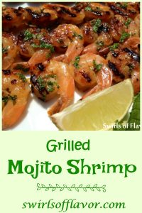 Mojito Shrimp is a twist on the classic rum cocktail.  An easy marinade of mint, rum and lime flavors the shrimp in just a few minutes. Grill or broil and you'll have a fabulously delicious Cuban cocktail-inspired seafood dinner! #shrimp #grilling #grilledshrimp #seafood #dinner #easyrecipe #rummarinade #summer #swirlsofflavor