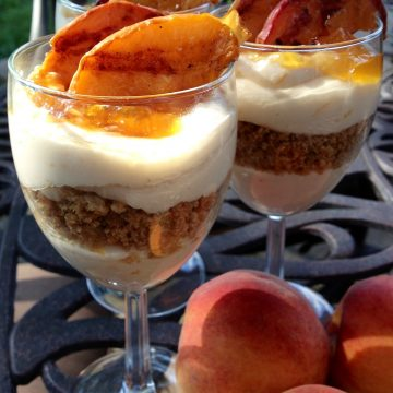 Grilled Peach Cheesecake Parfaits is an easy no-bake recipe for a summer dessert. A no-bake cheesecake mousseparfait topped with grilled fresh peaches fromthe farmers market will be a delicious ending to your summer meal! no bake   dessert   peach   summer fruit   easy recipe   cheesecake   cheesecake mousse   #swirlsofflavor