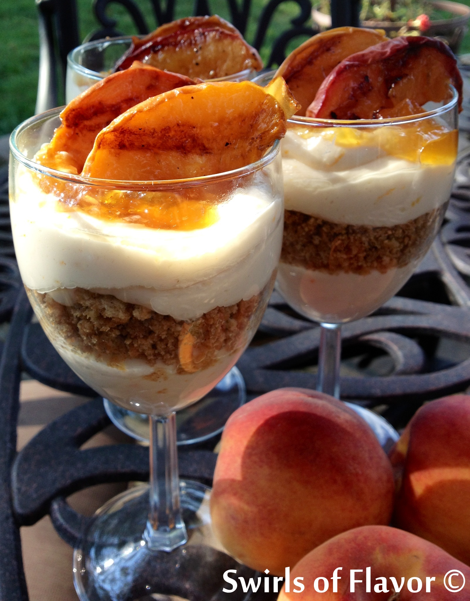 Swirls of Flavor's Grilled Peach Cheesecake Parfaits are featured on ...