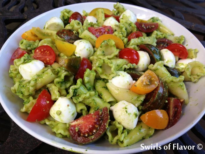 Make Pesto Florentine Campanelle Pasta and toss pasta with pesto, tomatoes, bocconcini and Parmesan, just 5 ingredients, for a bowl full of fresh summertime flavors! pasta | easy recipe| heirloom tomatoes | side dish | Meatless Monday | cheese | picnic | barbecue | homemade pesto | #swirlsofflavor