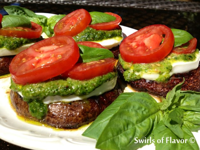 Balsamic Portobellos Caprese in a Balsamic marinade are grilled then topped with fresh mozzarella, pesto, compari tomato slices and fresh basil leaves, grilling | mushrooms | vegetarian | Meatless Monday | pesto | hamburger substitute | caprese