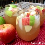 Apple Cider Sangria is an easy recipe that adds a fall spin to your sangria! Apple cider, applejack brandy and a sweet white wine combine with a hint of vanilla to create your new favorite fall cocktail!