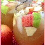stemless glasses of apple cider sangria