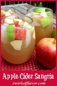 glasses of apple cider sangria with apple and text overlay