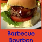 Close up of a glazed Barbecue Bourbon Slider with bacon lettuce and tomato
