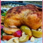 roasted apples, onions and chicen with spices and text overlay
