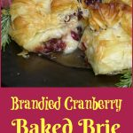 Phyllo Wrapped Brandied Cranberry Baked Brie is an easy recipe of phyllo dough layers surrounding a cranberry brandy topped Brie accented with a hint of rosemary and Dijon and a touch of spice. This holiday appetizer recipe will impress your guests for sure! #bakedbrie #brandy #cranberry #phyllodough #appetizer #holiday #Thanksgiving #swirlsofflavor
