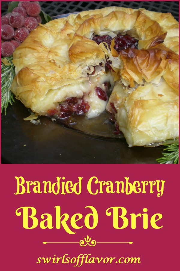 Phyllo Wrapped Brandied Cranberry Baked Brie is an easy recipe of phyllo dough layers surrounding a cranberry brandy topped Brie accented with a hint of rosemary and Dijon and a touch of spice.This holiday appetizer recipe will impress your guests for sure! #bakedbrie #brandy #cranberry #phyllodough #appetizer #holiday #Thanksgiving #swirlsofflavor