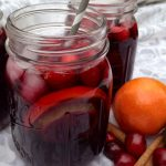 Cranberry Sangria is an easy cocktail recipe that will warm you up during the holiday season with rich bodied wines and a hint of spice! Red wine, spiced rum and port combine with cranberry juice, fruits and spices for a flavorful easy sangria recipe.