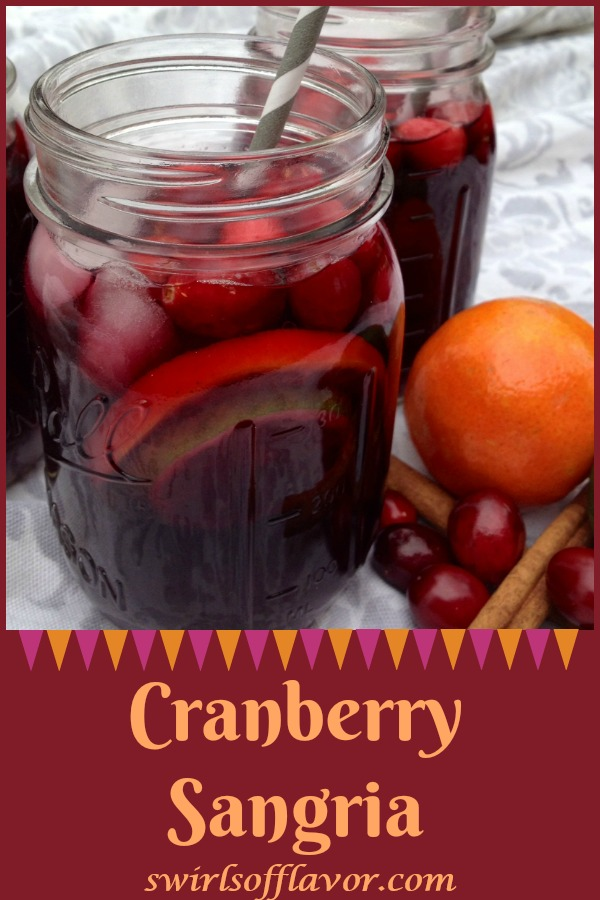 Cranberry Sangria is an easy cocktail recipe that will warm you up during the holiday season with rich bodied wines and a hint of spice! Red wine, spiced rum and port combine with cranberry juice, fruits and spices for a flavorful easy sangria recipe. #sangria #cranberry #cranberrysangria #easysangriarecipe #holiday #cocktail #holidaycocktail #fruitysangria #swirlsofflavor