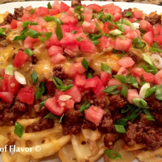 Cheesy Chili Smothered Waffle Fries