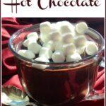 mug of hot chocolate with mini marshmallows and text overlay