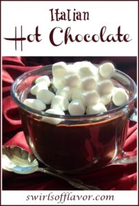 mug of hot chocolate with mini marshmallows and text overlay