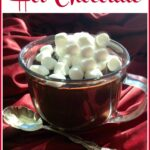 mug of hot chocolate with marshmallows and text overlay