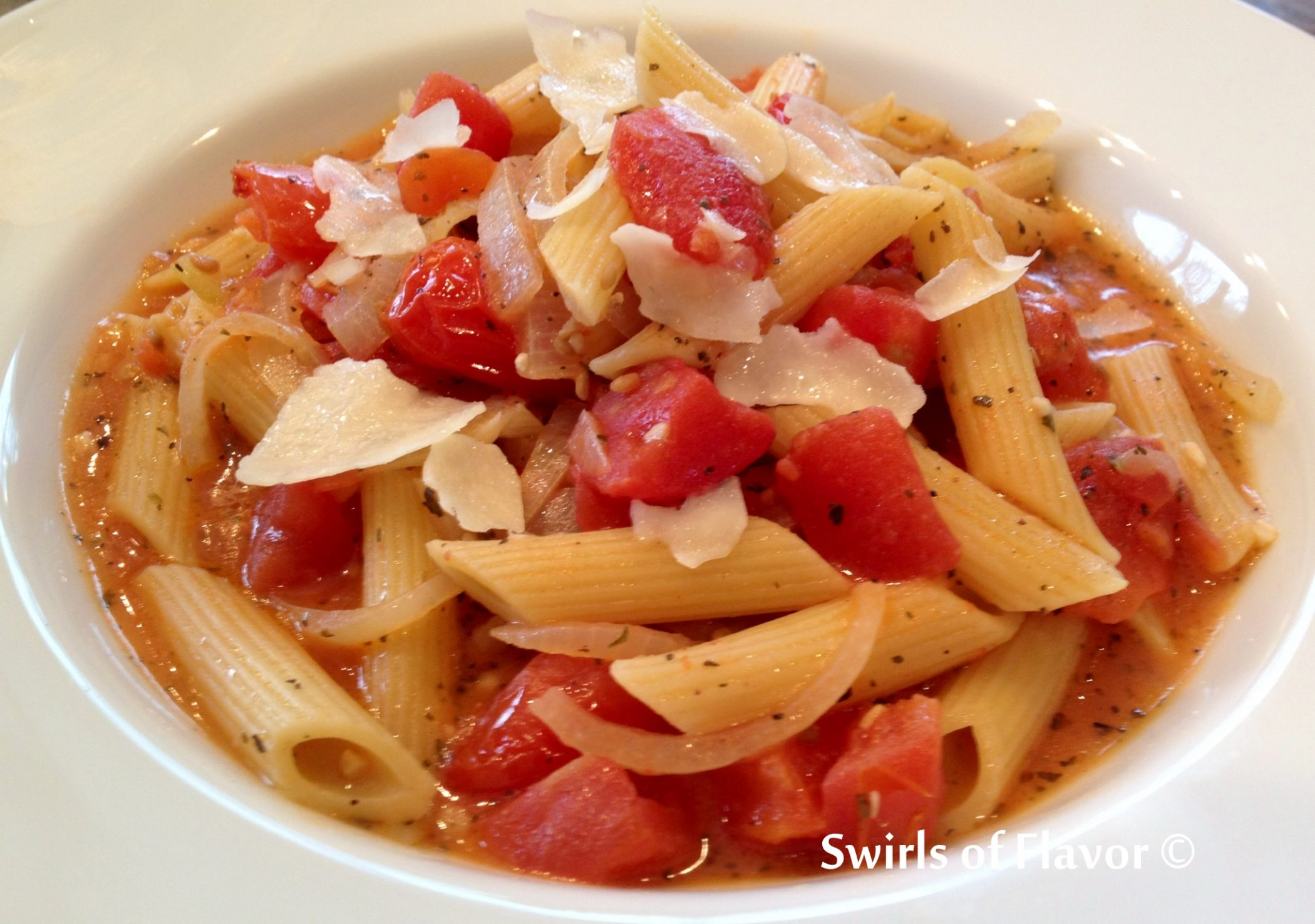 Penne Pomodoro with shaved Parmesan cheese