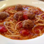 Spaghetti and Meatball Soup is a fun twist on the all-time favorite comfort food. All the elements of a traditional spaghetti and meatball dinner, spaghetti, meatballs and tomatoes, are combined in a bowl of soup! An easy recipe that's on the table in less than 30 minutes and so much fun for kids too! #spaghetti #meatballs #spaghettiandmeatballs #soup #homemade #funforkids #easyrecipe #lessthan30minutes #swirlsofflavor