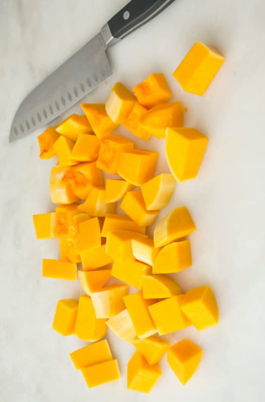 butternut squash cut up with chef knife