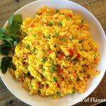 Fiesta Saffron Rice is an easy side dish that starts with a rice package that includes seasonings. Add fresh vegetables for a fiesta of flavors and colors! Perfect for Cinco de Mayo and quick and easy for a weeknight dinner.