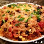 One Pot Mexicali Bowtie Pasta, an easy recipe for a busy weeknight dinner that cooks in just minutes in one pot, and is bursting with corn, black beans, pasta and cheesiness! Bowtie pasta cooks together in one pot, with salsa, butter, chili powder and cumin that becomes a light flavorful sauce, for a pasta dinner with a Mexican flair! #pasta #onepot #onepotrecipe #easydinner #easyrecipe #Mexican #cheese #blackbeans #familyfavorite #swirlsofflavor