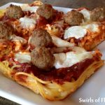 Deep Dish Spaghetti and Meatballs Pizza is a twist on the traditional spaghetti and meatballs dinner. Spaghetti is your pizza crust and meatballs are your topping along with cheese and sauce. #spaghetti #spaghettiandmeatballs #pizza #spaghettipizza #deepdishpizza #homemadepizza #funforkids #easyrecipe #appetizer #dinner #movienight #snack #swirlsofflavor