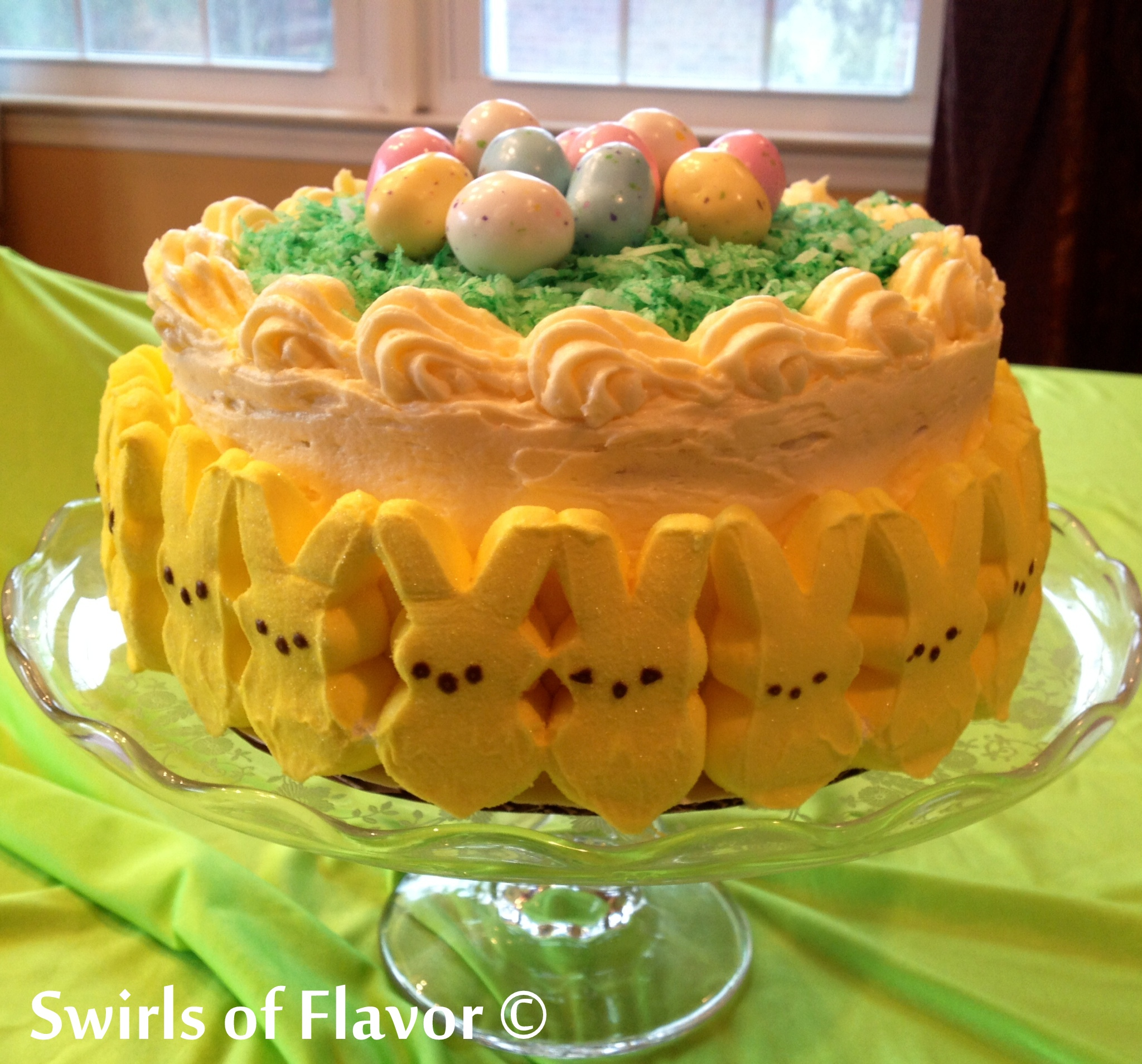 lemon layer cake with Easter decorations on a cake stand