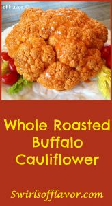 As the Whole Roasted Buffalo Cauliflower roasts in the oven hot sauce seeps into the florettes giving you a taste of heat with every bite! roasted | roasted cauliflower | buffalo sauce | vegetable | side dish | dinner